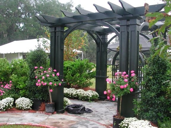 love the black pergola If I did one I would use this color only