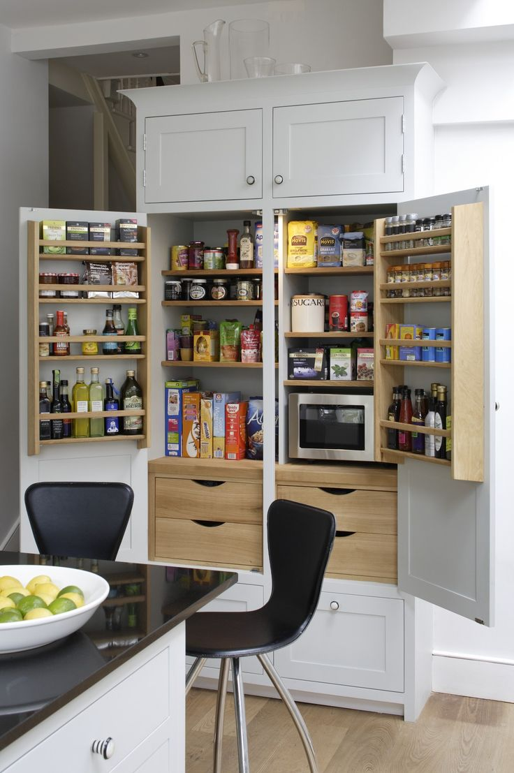 Higham - A tall multi-functional larder painted inside with Oak accessories