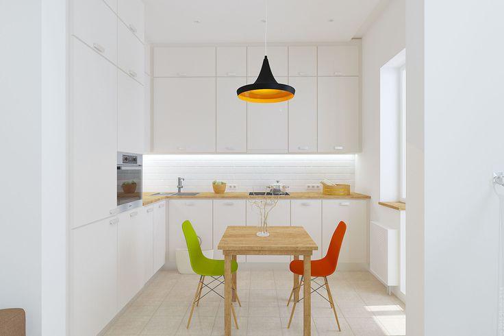 Яркие акценты в белой лаконичной кухне - цветные стулья и современная люстра.