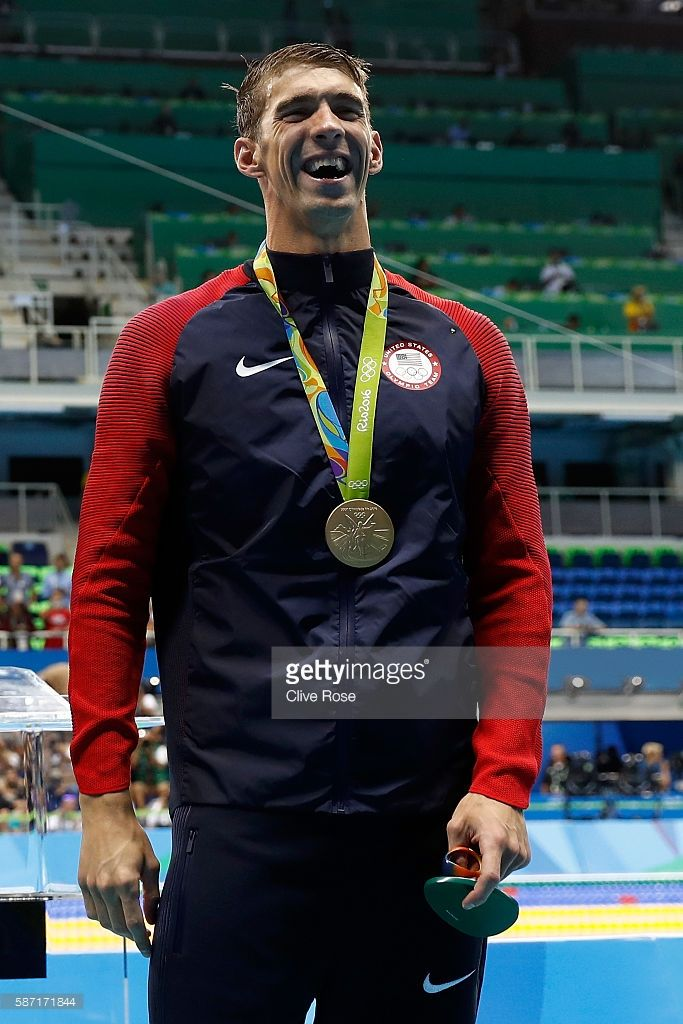 Michael Phelps of the United States celebrates after winning the gold medal in the Men's 4 x 100m Freestyle Relay on Day 2 of the Rio 2016 Olympic Games at the Olympic Aquatics Stadium on August 7, 2016 in Rio de Janeiro, Brazil. The gold medal is the 19th of Phelps career.