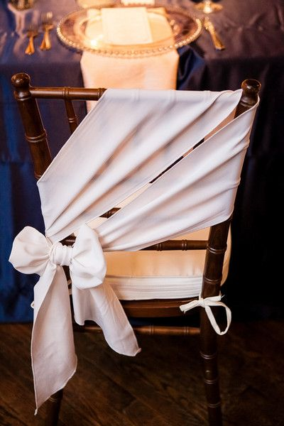 Elegant bow chair decor idea - sheer fabric tied in a bow on the back of chiavari chair {The Collection}