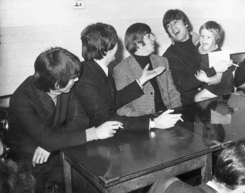 10th October 1964. The Beatles backstage at the De Montford Hall in Leicester with young fan Karen Spenoe from Pudsey, Yorkshire.