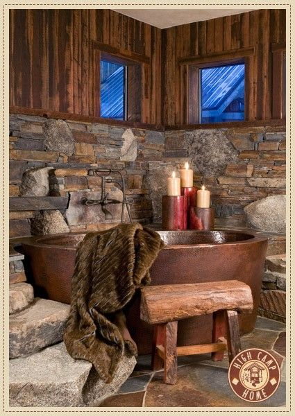 Country bathroom - favourites are the wooden bench and rock/wood walls. Ideal for a basement washroom -warm and unexpected