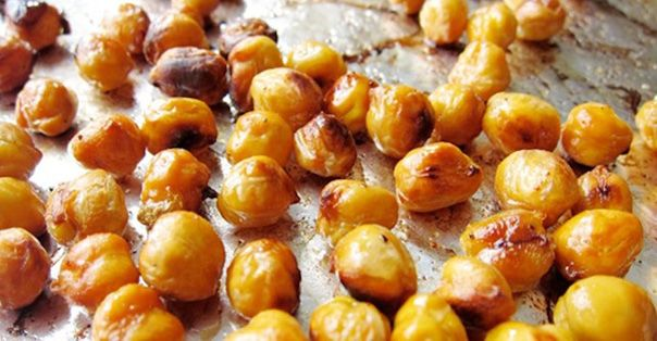 These are seriously yummy.....I love chickpeas now!!- Drain and rinse 1 can of chickpeas and add to a bowl. Add 1 tablespoon of olive oil, ½ teaspoon of salt, and ½ teaspoon of cayenne pepper and toss to coat. Arrange in a single layer on a foil-lined baking sheet and bake for about 15 minutes at 450 degrees. Take them out and shake 'em around before returning to the oven for another 15 minutes,