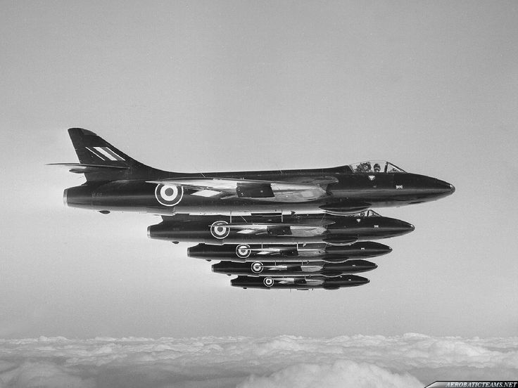 Royal Air Force Black Arrows Hawker Hunter F.6 fighters flying in formation, circa 1957. The Black Arrows were the predecessor of the modern day Red Arrows. (Photo: AerobaticTeams.net)