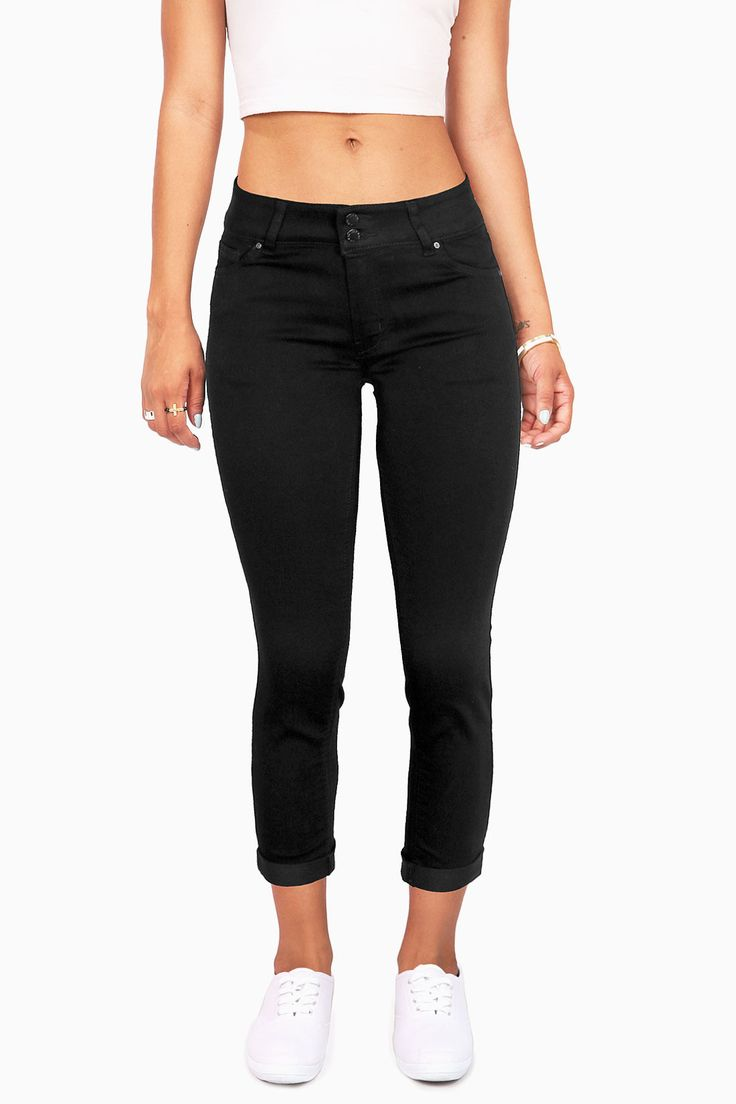 Mid rise capri jeans with a cuffed hem and super stretchy fit. Black hardware for a sleek look. Traditional 5 pockets with a button and zip fly closure. *Machine Wash Cold *75% Cotton 23% Polyester 2%
