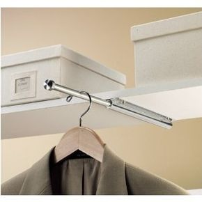 Hidden clothes rod for laundry room. I definitely need this because *somebody* (not me) always leaves HIS clothes in the laundry room despite having a closet. ;)