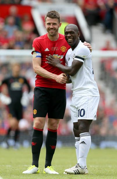 Manchester United's Michael Carrick with Carrick All Stars' Clarence Seedorf during Michael Carrick's Testimonial match at Old Trafford Manchester