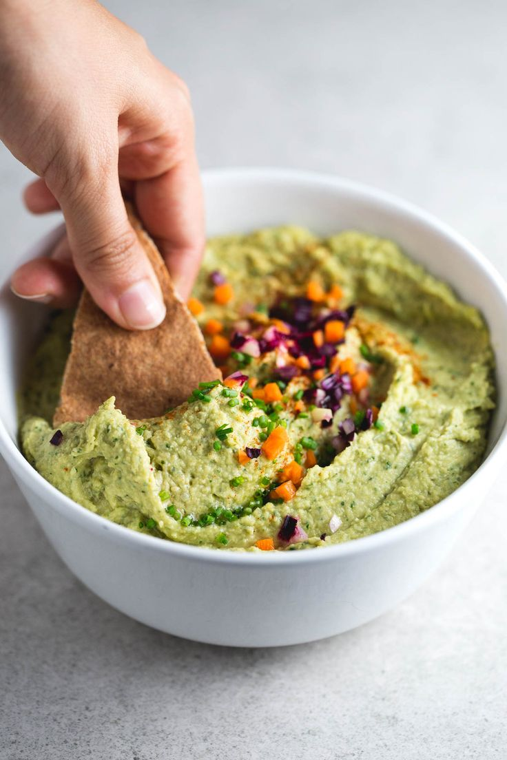 This vegan pesto hummus is a delicious appetizer or spread. It's a super healthy and simple recipe and is really easy to make.