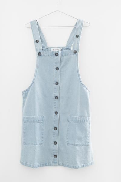 - Light denim overall dress - Button down front - Large front patched pockets - Strap length is adjustable - Non-stretch light cotton denim - Loose fitting - 100% Cotton - Imported