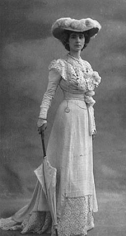 Edwardian style, 1905 Baroness Olga de Meyer in white dress with parasol.