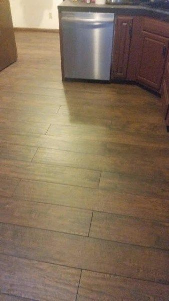 My floors are down and grouted…holla! After weeks of floor issues in the kitchen, I finally see the light at the end of the tunnel. The problem I'm facing now is dreaded grout haze on my tile. I asked my tile guy how to remove it and he said I just needed to sponge it …