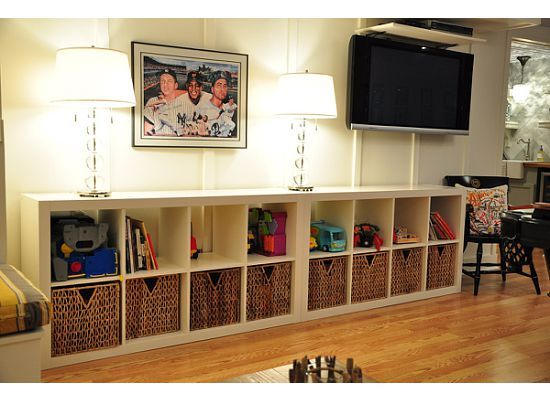 Hey Kathy another idea for the living room all along that one wall....where you wanna mount the tv.....toy storage for living room? Going to do this with Brown shelves & Baskets!