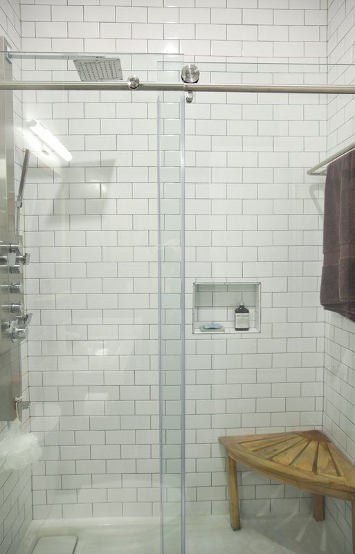 Things I like in a shower: Built-in nooks for bath items and a seat to make shaving one's legs easier.