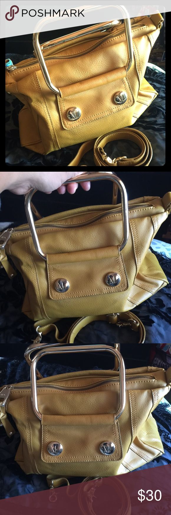 MANGO handbag with top handle and cross body strap Used once.  Authentic MANGO vintage yellow handbag with top handle and cross body strap. Mango Bags Crossbody Bags