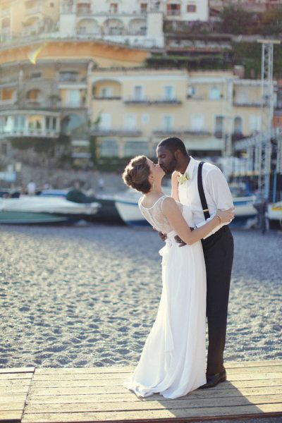 Interracial couple wedding photo. Love. Such a beautiful picture... especially the suspenders and bowtie :)