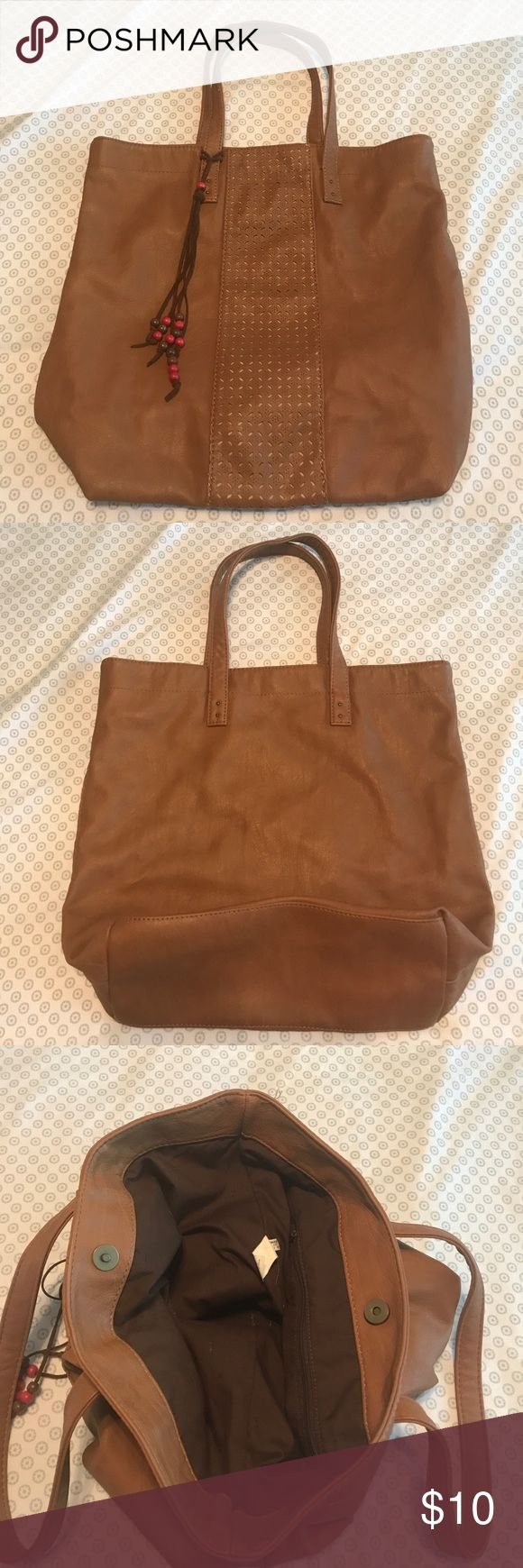 Faux Leather Tote Bag This hip tote bag will carry all your summer needs. One zip pocket on the inside. Magnetic button closure. 17x5x15 LxWxH American Eagle Outfitters Bags Totes
