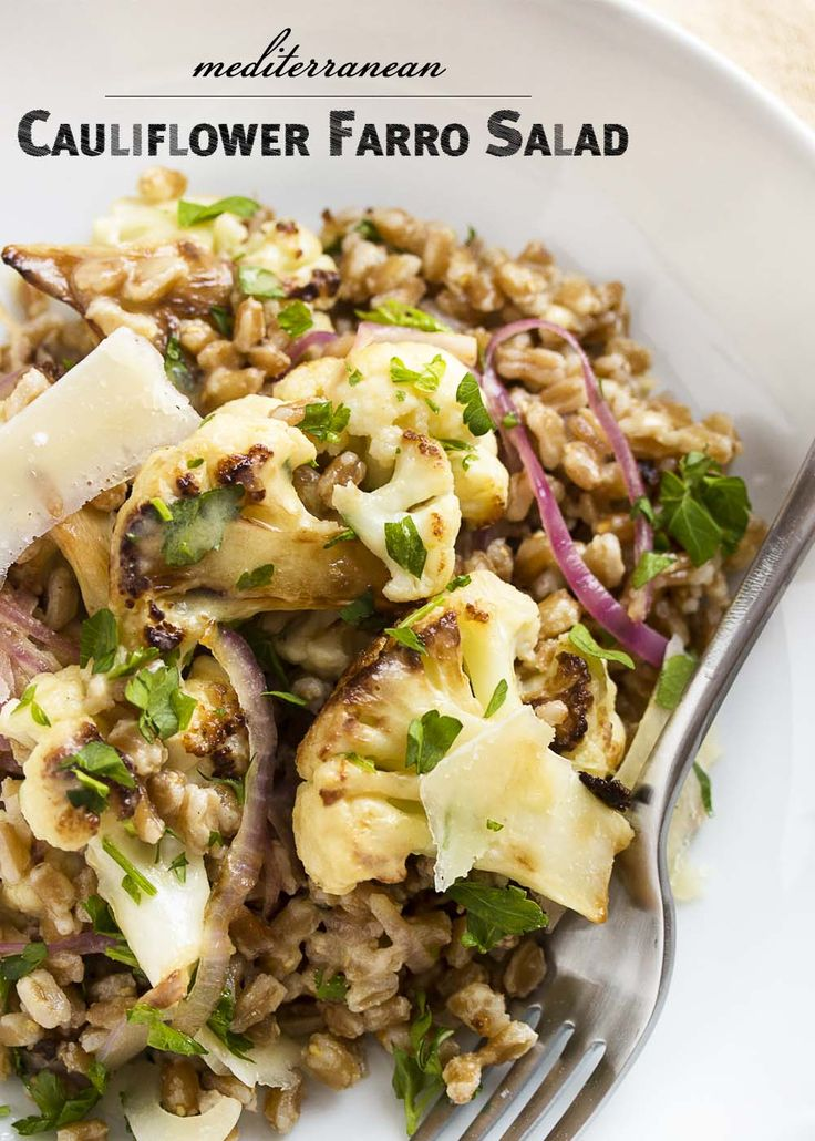 This warm Mediterranean farro salad is tossed with pan roasted cauliflower and creamy tahini lemon dressing to make a great winter salad. | justalittlebitofbacon.com
