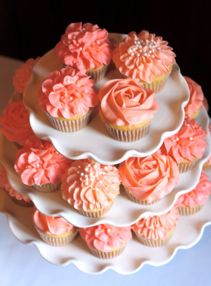 Pretty summery coral coloured cupcakes! perfect for summer weddings :)