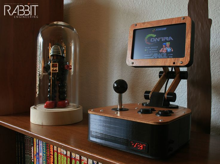 The Rabbit Engineering Model G1 is a Bauhaus inspired tabletop arcade machine that plays Nintendo NES cartridges. More info at http://www.rabbitengineering.com