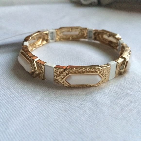 White and gold bracelet Gold with white details. New with tags. Jewelry Bracelets