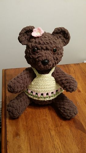 """This adorable bear will delight the hearts of any age! You can embellish with clothing or bows if you'd like. This works up pretty quickly with the bulky yarn. I can get 2 bears out of a big ball of bernat blanket yarn (220 yrds). This bear is about 9"""" tall."""