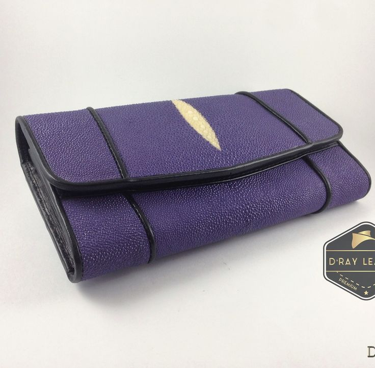 A stingray wallet for woman by @drayleather   Purple Color. These stingray wallets have a pebbly texture with a highlighted central diamond.  . A beautifully handmade example of a sting ray wallet with a full cow skin interior. . • Hand selected stingray skin direct from the tannery. • Hand cut leather • A grade cowskin interior • 19cm x 10cm • card holders • ID holders • compartments • Bill divider • Fine stitched edge . Delivery Worldwide   Free Shipping 100% Brand ..