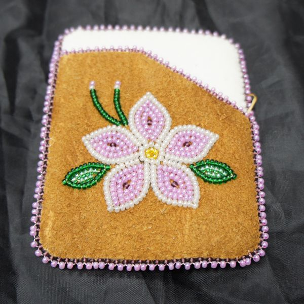 Carry your debit, credit and I.D cards around in style with this unique card holder, made of moose hide with a pink stroud interior and a beaded flower design.  Hand crafted with care in Fort Liard, Northwest Territories in Canada's far North.   Support the Aboriginal arts and crafts industry and buy online today.
