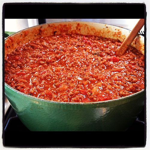 Pioneer Woman's Meat Sauce  Cut the meat down to 3 lbs (2 ground sirloin, 1 mild sausage), used 1tsp oregano, 1 tsp Italian seasoning, white wine and left out red pepper flakes. Incredible flavor!!!!
