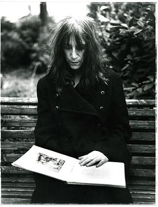 Poet and songwriter Patricia Lee 'Patti' Smith reading outside.
