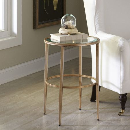 A glamorous mix of clear tempered glass and gold-finished metal, the look of this side table is both airy and luxe.Features:M...