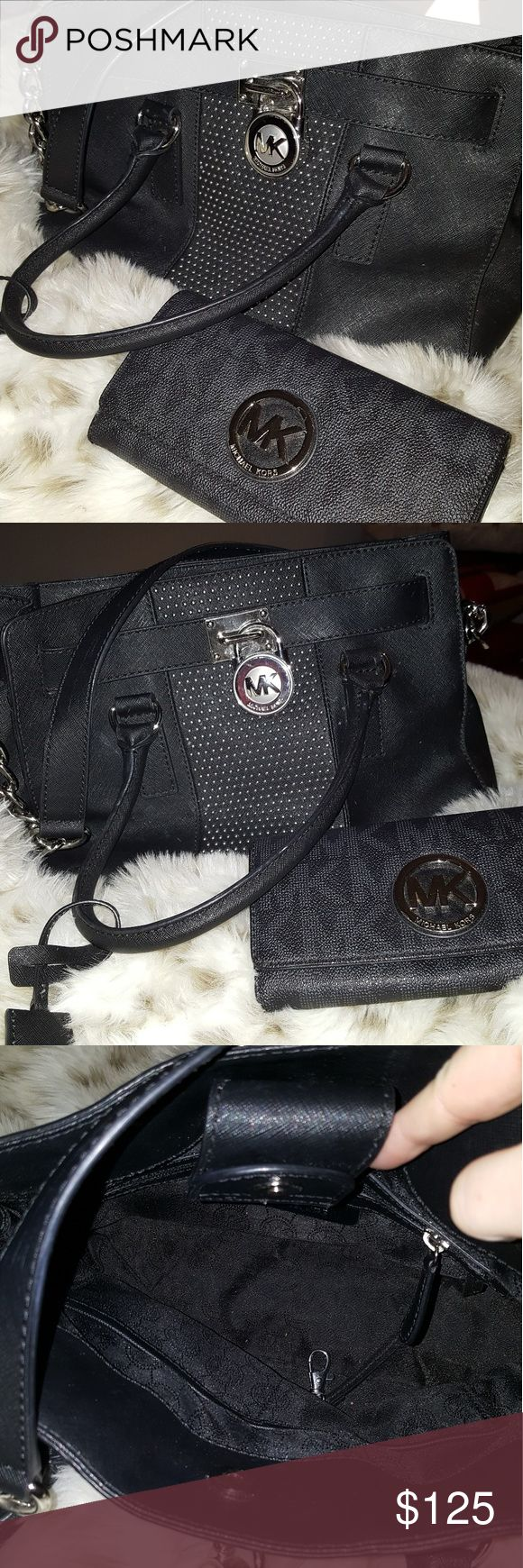 Authentic Michael Kors purse and matching wallet Get in style for the fall with this matching set. Black MK purse with  silver tone chain accent and mk locket. Black 2 tone mk wallet with large emblem on the front Don't miss out on this great deal.... Michael Kors Collection Bags Shoulder Bags