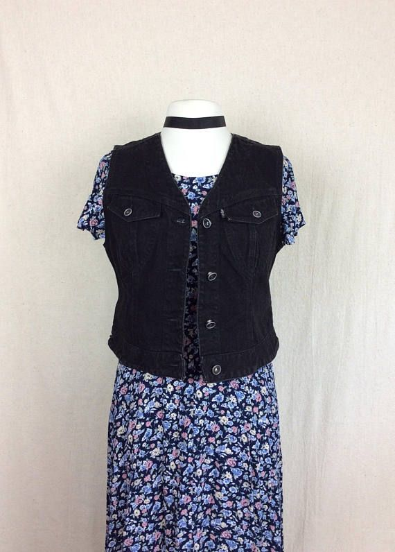 Vintage Levis Black Denim Vest by Levi Strauss & Co. Womens Size Medium   An amazingly versatile black jean vest tailored to fit a womans body. This is a great vintage piece that goes well with everything. An essential for layering your outfits. Its a more unique cut for a Levis vest