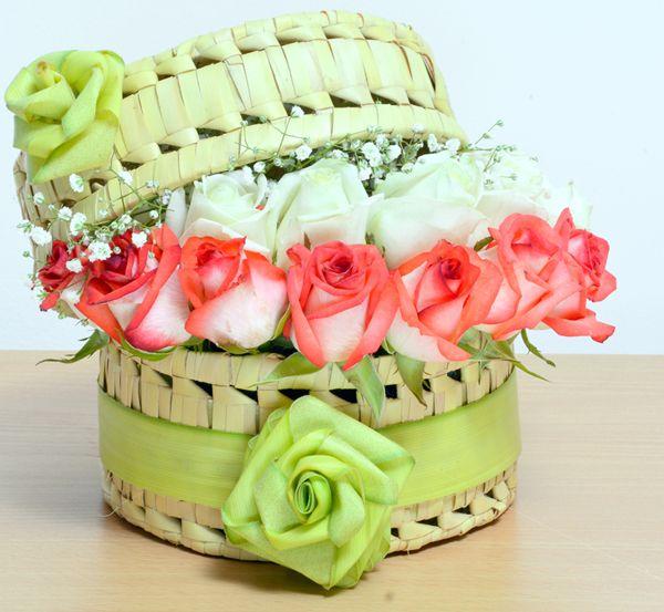 Lavish Roses: A vibrant profusion of #FreshRoses & #Gypsophilia in a basket. #FreshFlowers #FlowerArrangement #NotJustFlowers
