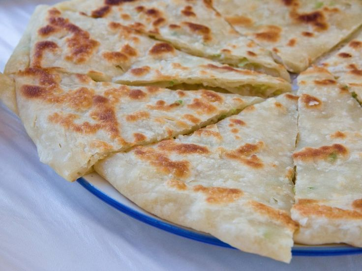 To make cong you bing — the Chinese version of a savory pancake — chopped scallions are folded into delicious flatbread.