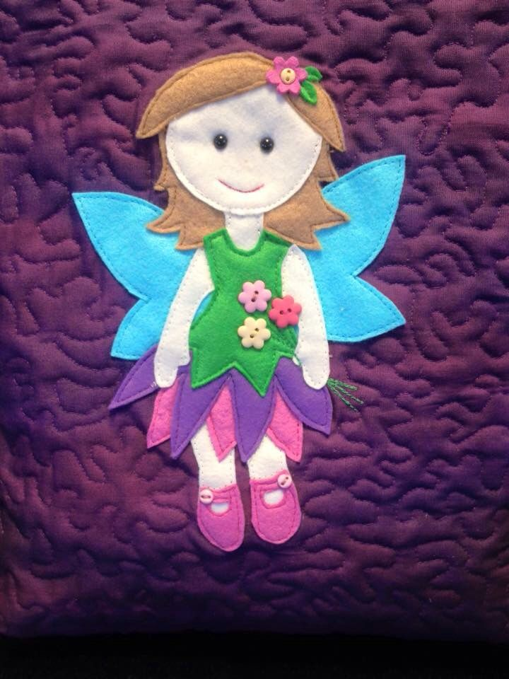 A quilted fairy book bag I made for my niece with her favourite colours :)