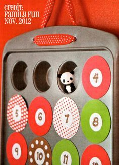 Advent-Calendar from mini-muffin pan and magnetic circles. Love that you can put in tiny surprises.