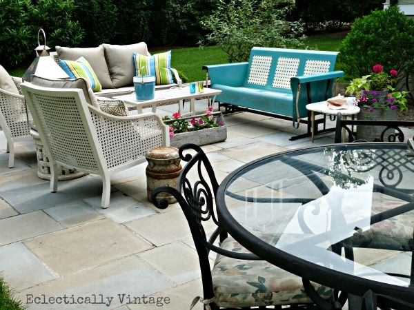 Eclectic Patio with Vintage Glider - lots of great ideas for a one of a kind look eclecticallyvintage.com