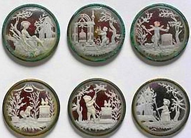 Set of six buttons, carved ivory on tinsel with glass and metal mounts, depicting amorini and shepherdesses in landscapes, French (Dieppe),…