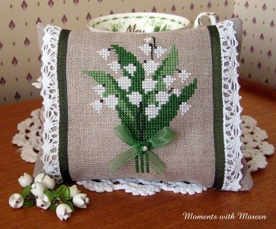love this Lily of the Valley cross stitch ornament with the lace and tiny bow details