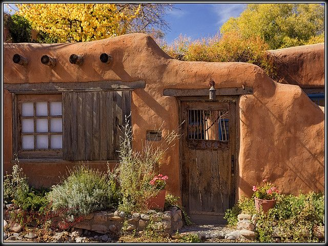 Old Adobe with wooden door, Santa Fe, NM  photo by Mike Jones