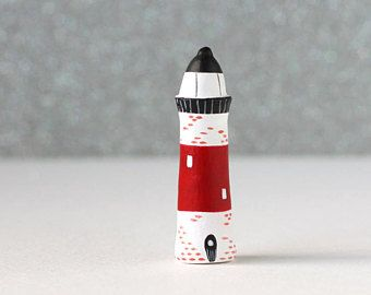 Little clay home - little white and black lighthouse with big red stripe and bricks