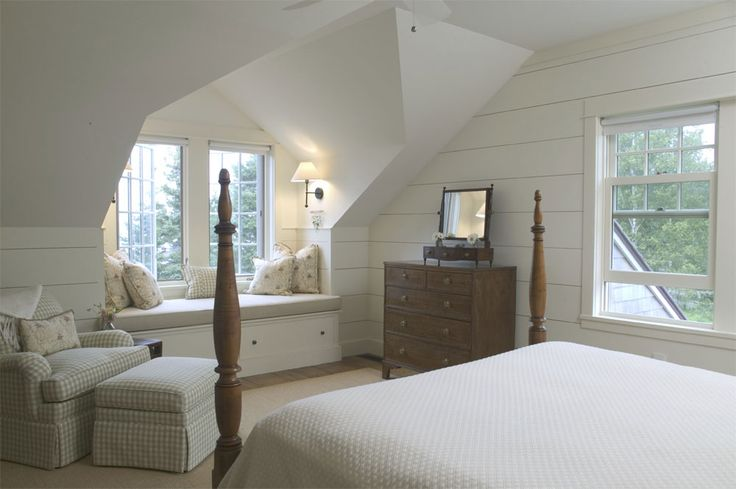 attic bedroom with tongue and groove siding and a window seat