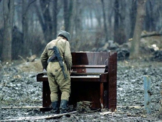 A Russian soldier, playing a lost piano
