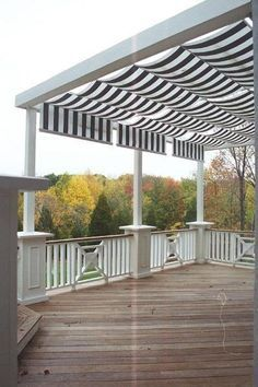 Shadetree Canopy retractable awnings installed over a mahogany deck in Butler Township just north of Dayton Ohio - Awnings Photo Gallery - Archadeck of West Central & Southwest Ohio