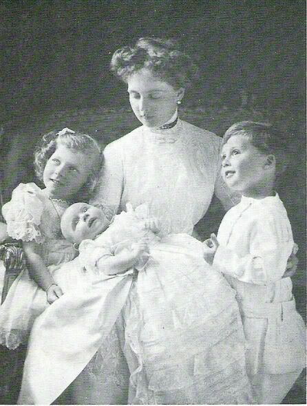Princess Alice, Countess of Athlone with her 3 children:  Princess May, Prince Maurice, and Prince Rupert.  Sadly, little Maurice died a few months after this portrait was taken.