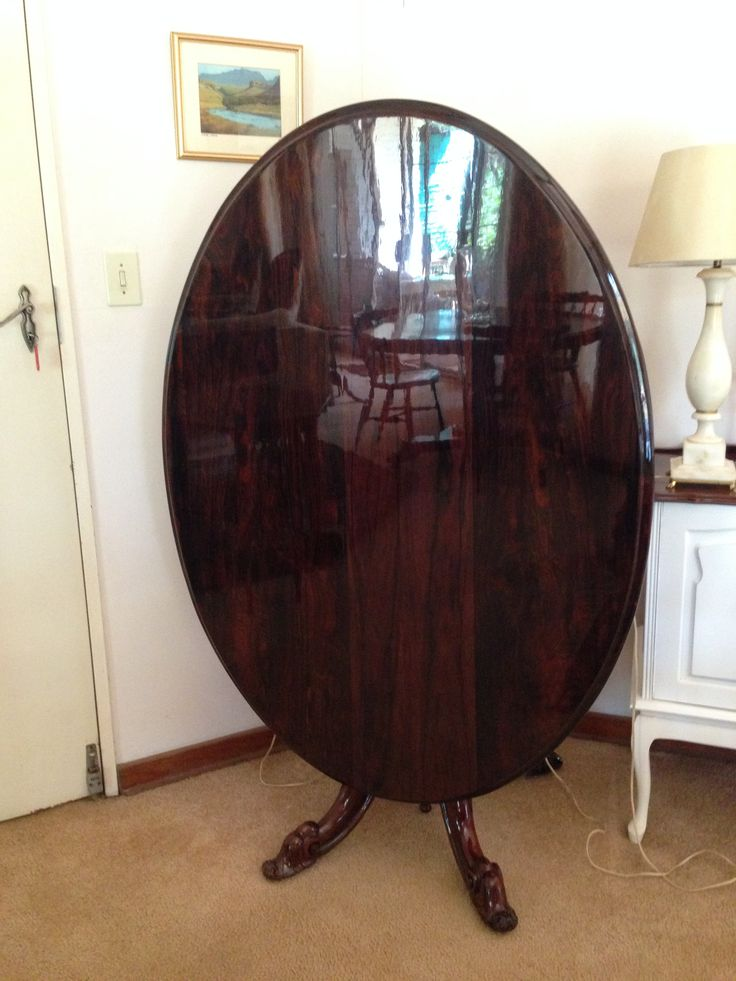 High gloss finish applied to restore the tabletop of an antique rosewood table. What a beautiful piece!
