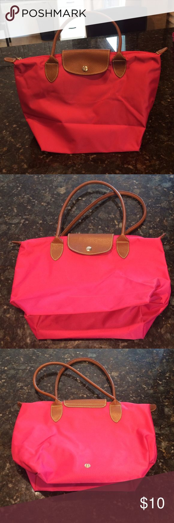 Long champ replica small bag This is a replica long champ bag in the size small. Bright pink with brown handles. Bags Shoulder Bags