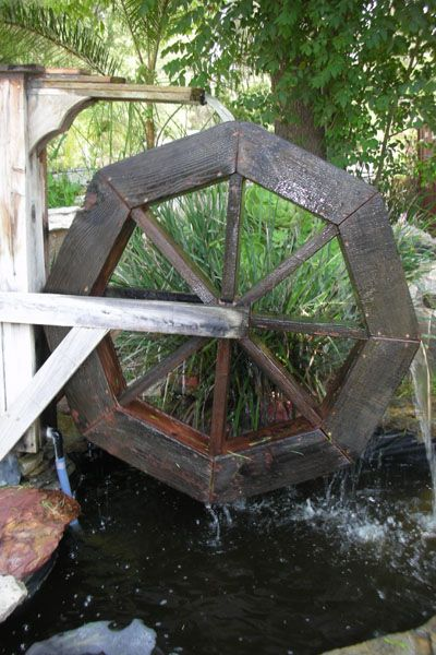 Small Ponds and Fountains: Water Wheel: Custom Ponds - http://sunlandwatergardens.com/swg_products/small-ponds-and-fountains-water-wheel/