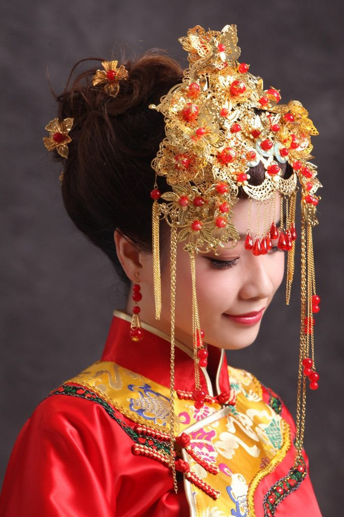 "Chinese Wedding Phoenix Bridal Crown Headdress - An ancient Chinese custom is for the bride's hair to be styled in the ""glow"" of dragon and phoenix candles (which symbolize the union of man and woman) and she should wear a red veil under a phoenix bridal crown"